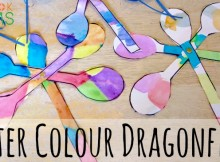 Water colour dragonfly painting with curled paper antennae and brad fasteners