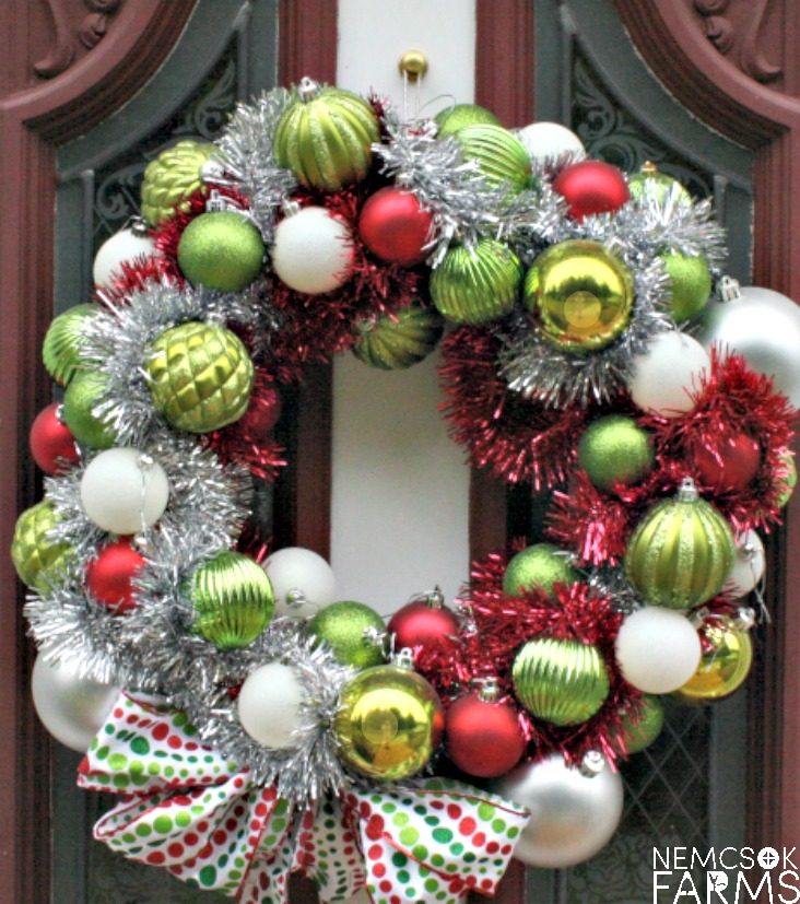 DIY Christmas Ball Wreath.  Create your own fabulour Holiday Decor for Christmas with your stockpiles of christams bauble deocrations, and hot glue.  And don't forget your friends