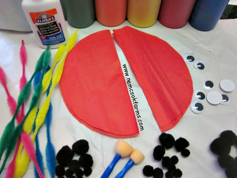 Paper plate lady bugs with pom poms and googly eyes - super fun bug craft for kids