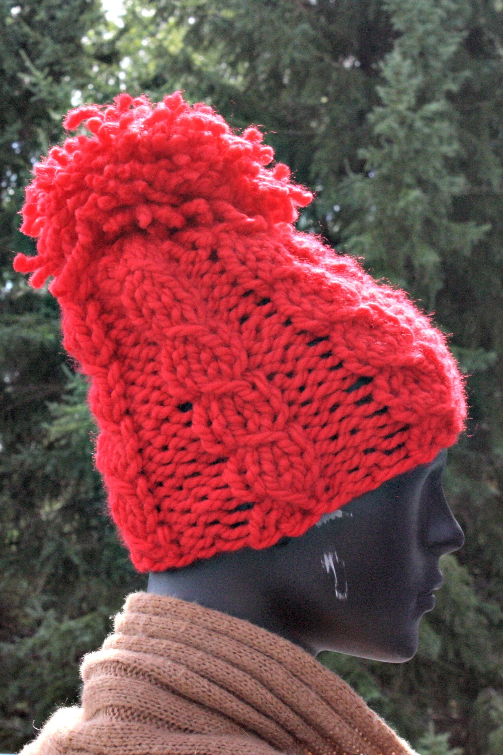 The Twisted Stitch Pom Pom Hat - Super Duper Knit Hats for Beginners - book of fabulous knitting patterns for hat suited for beginners and professionals